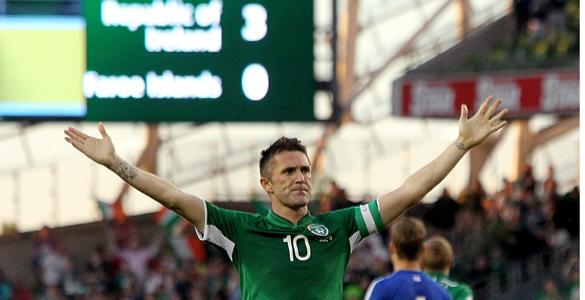 Robbie Keane celebrates scoring his third goal against the Faroe Islands. (Pic: PA)