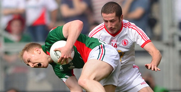 HARD GRAFT: Tom Cunniffe ships a heavy challenge from Tyrone's Stephen O'Neill (right) during Mayo's semi-final win over Mickey Harte's side. Pics: Adrian Melia
