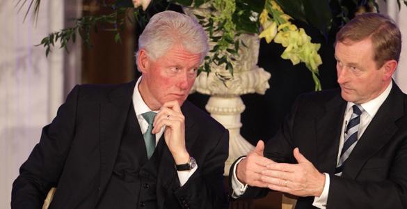 Former US president Bill Clinton listens to Taoiseach Enda Kenny at the 2011 Global Irish Economic Forum in Dublin Castle.
