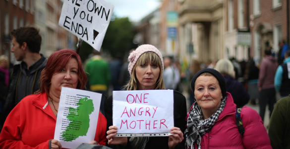Protestors gather outside Leinster House in Dublin as politicians return after the summer recess