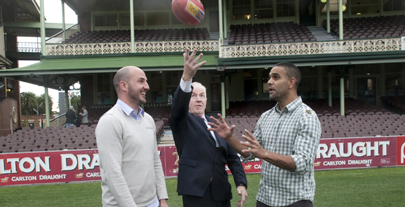 Australia's International Rules coaching team of Michael O'Loughlin and Tadhg Kennelly with visiting minister Jimmy Deenihan at the SCG.