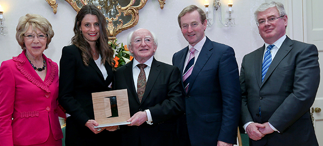 Sam Stynes accepts the Presidential Distinguished Service Award (PDSA) from president Michael D Higgins in 2012. Also pictured is Sabina Higgins, Taoiseach Enda Kenny and Tánaiste Eamon Gilmore.