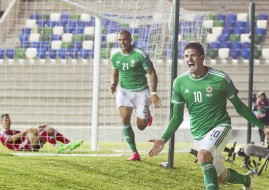 Northern Ireland's Kyle Lafferty celebrates scoring his side's first goal of the game during the UEFA European Championship Qualifying match at Windsor Park, Belfast. Pic: Liam McBurney/PA Wire
