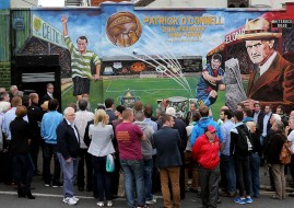 Crowds gather as a new mural is unveiled in Belfast to mark the life of footballer Patrick O'Connell, whose career saw him play for Belfast Celtic and Manchester United and manage FC Barcelona.  PRESS ASSOCIATION Photo. Picture date: Thursday August 6, 2015. See PA story ULSTER Mural. Photo credit should read: Niall Carson/PA Wire