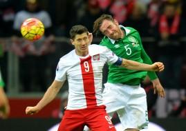 Republic of Ireland's Richard Keogh challenges Poland's Robert Lewandowski.