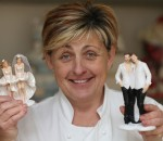 Beverly Murphy of Amazing Cakes displays same-sex wedding cake toppers at their shop in Bray Co Wicklow.