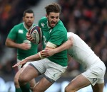 Ireland's Mike McCarthy is tackled during the Six Nations clash againt England at Twickenham.