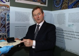 An Taoiseach Enda Kenny holds Patrick Pearse's spectacles as he attends the launch of 'Proclaiming a Republic: The 1916 Rising exhibition' at the National Museum of Ireland in Dublin. Pic: Brian Lawless