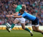 Robbie Henshaw kicks ahead during Ireland's Six Nations clash with Italy in Dublin.