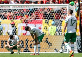Republic of Ireland's Ciaran Clark (left), Robbie Brady (centre) and Stephen Ward (right) count the cost after Belgium's Romelu Lukaku's goal.