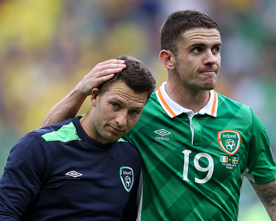 Republic of Ireland's Wes Hoolahan and Robert Brady after the final whistle during the UEFA Euro 2016, Group E match at the Stade de France, Paris. PRESS ASSOCIATION Photo. Picture date: Monday June 13, 2016. See PA story SOCCER Ireland. Photo credit should read: John Walton/PA Wire. RESTRICTIONS: Use subject to restrictions. Editorial use only. Book and magazine sales permitted providing not solely devoted to any one team/player/match. No commercial use. Call +44 (0)1158 447447 for further information.