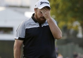Shane Lowry shows his disappointment after letting the US Open title slip through his fingers.